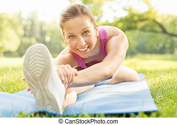 Stretching In The Park - Cute girl doing stretching...