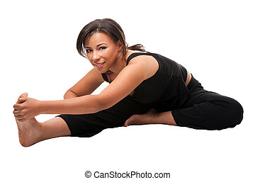 Beautiful attractive woman stretching exercise before her yoga workout, dressed in black, isolated.