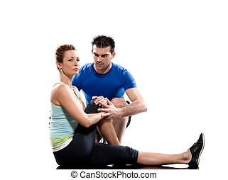 stretching workout posture by a couple, a man and a woman on studio white backgroun