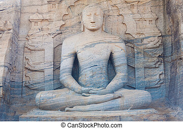 The front of a monolithic sitting Buddha, Gal Viharaya, carved from a unique striated granite rock at Polonnaruwa, the ancient kingdom capitol of Sri Lanka