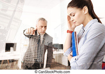 Strict boss arguing with his female employee