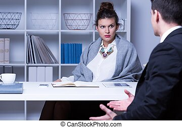 Strict businesswoman talking with employee