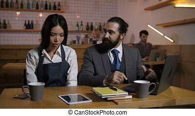 Strict manager reprimanding employee at cafe - Irritated...