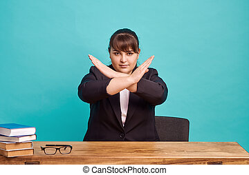 Strict overweight teacher shows stop gesture