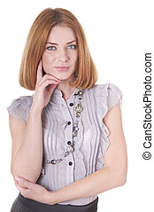 Portrait strict beautiful looking at a camera young woman in blouse and skirt on white