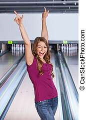 Strike! Teen girl rejoicing at a strike.