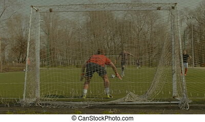 Striker scoring a goal after penalty kick - Young striker...