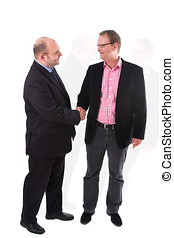 Striking a deal - Two businessman having just come to an...