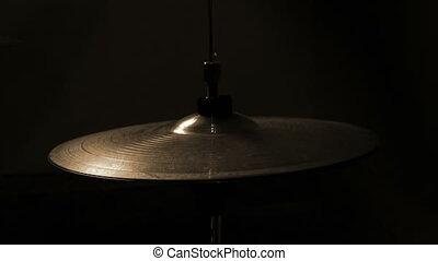 Striking with a stick on a hi-hat