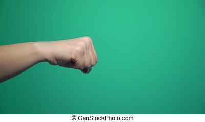 Striking with fist of hand. Kick jab strike on green screen...