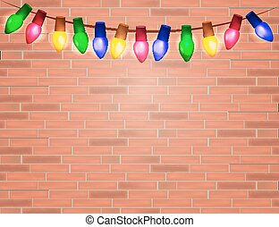 String of Color christmas light bulbs  on red brick background.