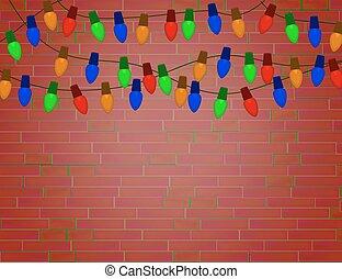 String of Color christmas light bulbs on red brick wall.