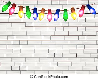 String of Color christmas light bulbs  on white brick background