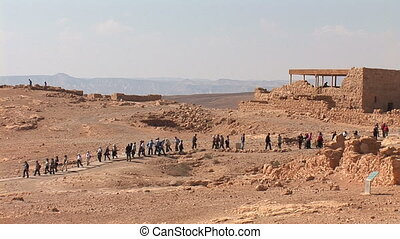 string of people in the Masada