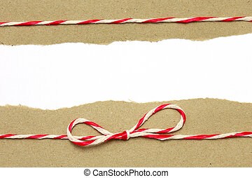 String red and white on brown wrapping paper with copy space background