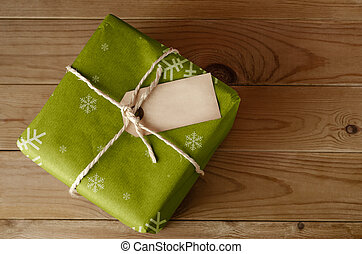 String Tied Green Christmas Parcel - Overhead shot of a...