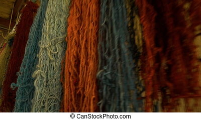 Strings hanging inside a factory - A moving shot of fibers...