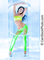 strip dance - Modern brunette girl dancer in a sexual...