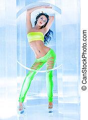 strip dance - Modern brunette girl dancer in a sexual...