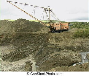 Strip Mining - Career dredge on extraction of gravel.