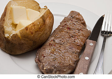 Strip Steak and Baked Potato with Butter
