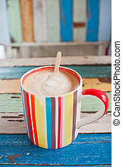 stripe coffee cup on retro background