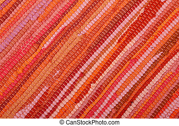 Striped Background in Warm Colors made from textile