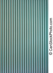 Striped background. Vertically structure of repeated green rolls