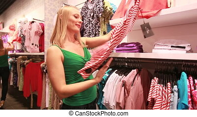 Striped blouse - Blond beauty admiring a striped blouse...