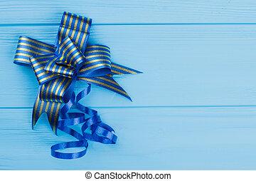 Striped blue bow gift ribbon.