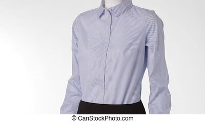 Striped blue shirt on mannequin. Female mannequin wearing formal clothes. Official clothing for ladies. Dark skirt with blue shirt.