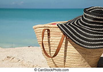 sun hat on the beach bag