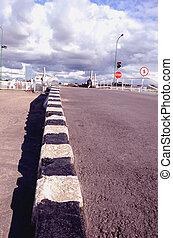 Striped border, traffic light, stop sign.