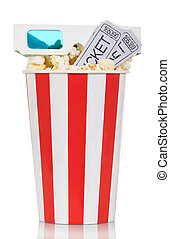 Striped box of popcorn with movie tickets and glasses...