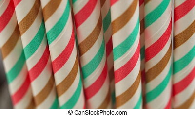 Striped cocktail tubules, holiday concept, camera movement, close-up