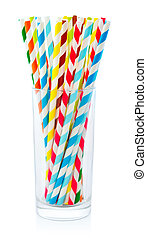 Striped drink straws of different colors in glass isolated...