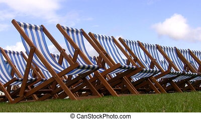 Striped folding chairs on grass