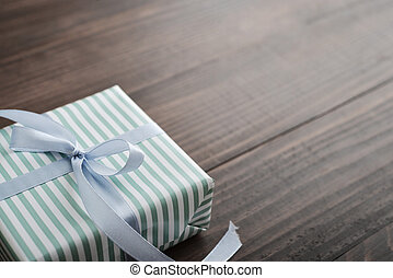 Striped gift box with blue ribbon