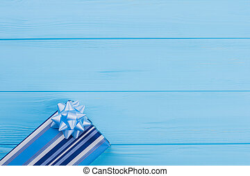 Striped gift box with bow.