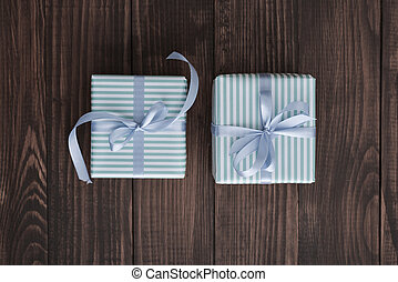 Striped gift boxes with blue ribbon
