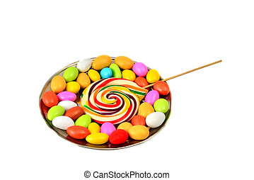 Striped lollipop and multicolored smarties isolated