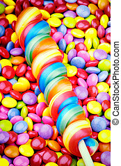 Striped lollipop and smarties - Striped lollipop and...