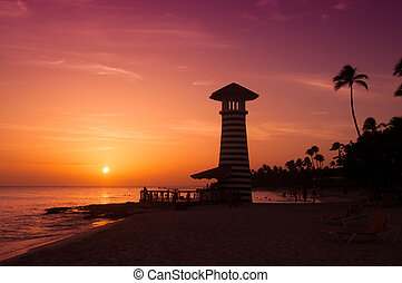 Striped red white lighthouse on the coast of the Caribbean Sea. Dominican Republic.