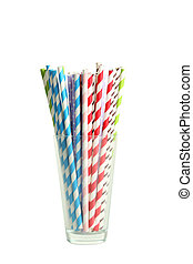 Striped straws for cocktails in glass on white background
