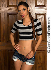 Striped tee - Beautiful young multiracial woman in a striped...