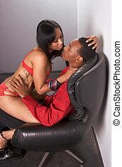Striper woman in red seducing young black man - Seductive...