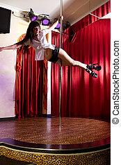 Stripper dancing on pole - Strip tease dancer hanging on the...
