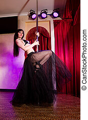 Stripper girl pole dancing in costume - Young attractive ...