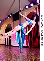 Stripper girl pole dancing in costume - Young attractive...
