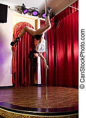 Stripper hanging on pole